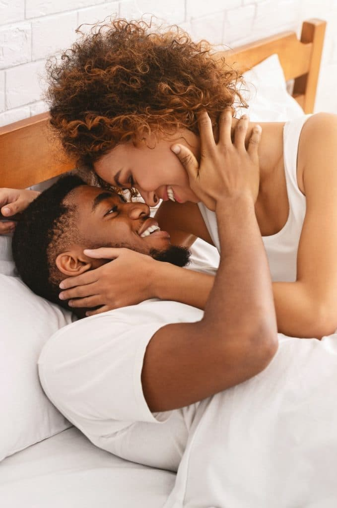 African couple of lovers relaxing in bed at home