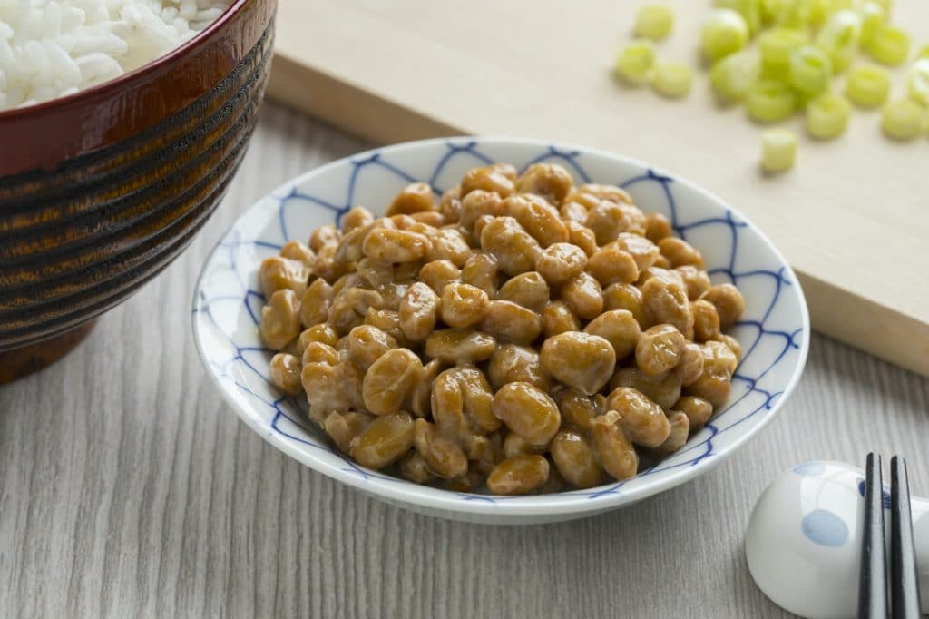 Bowl with traditional Japanese fermented soybeans called natto
