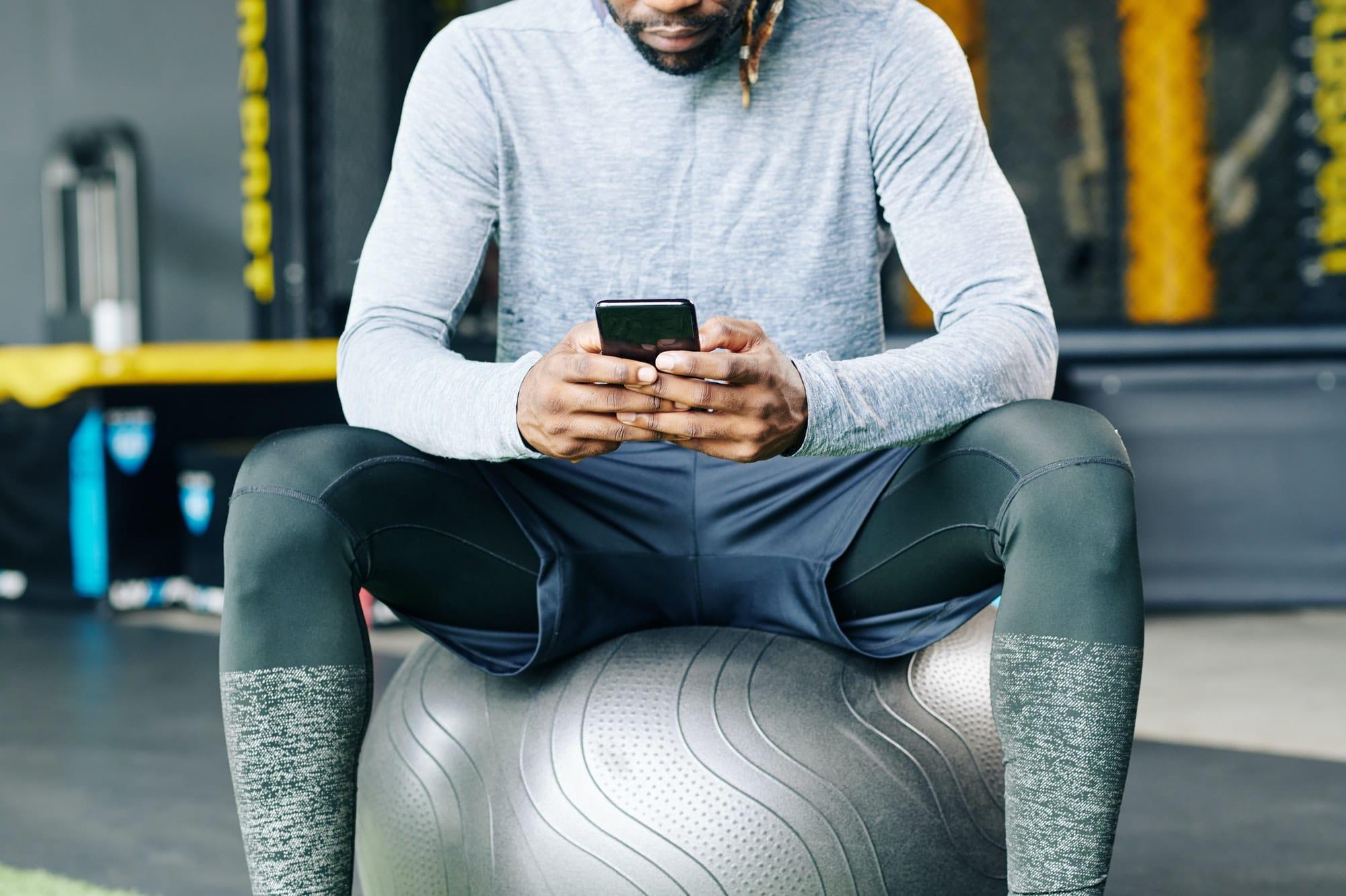 Sportsman checking health mobile app