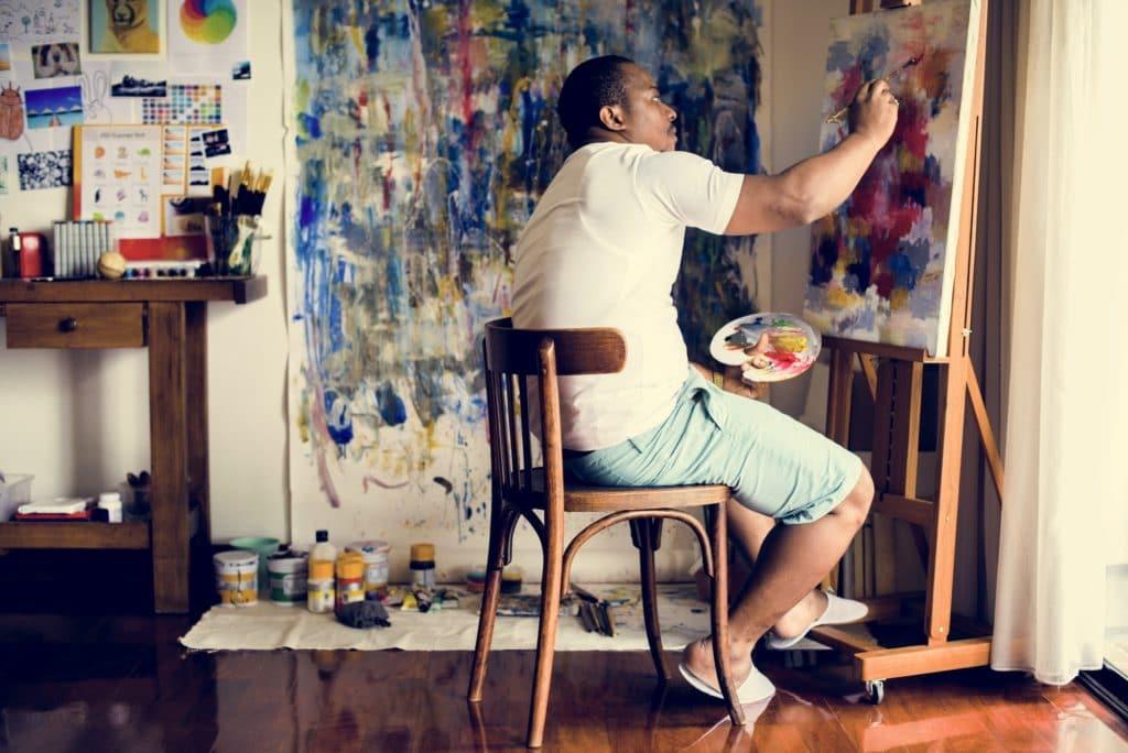 Black artist man doing artwork