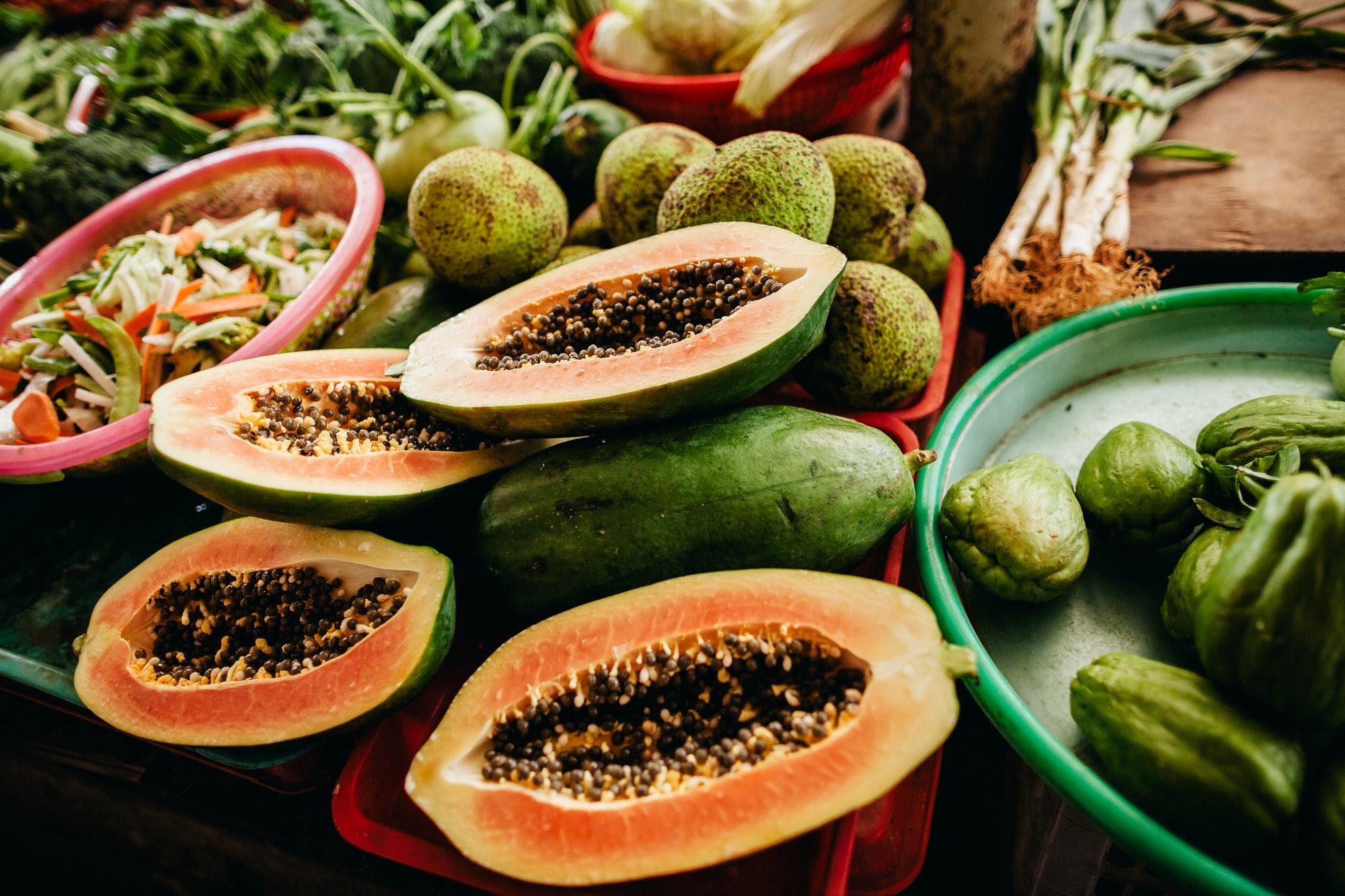 papaya cut at tropical market in asia